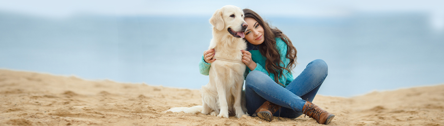 Women and her dog on the beach